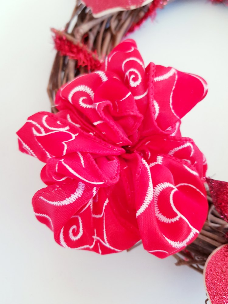 create a wired ribbon bow, and add it to the wreath