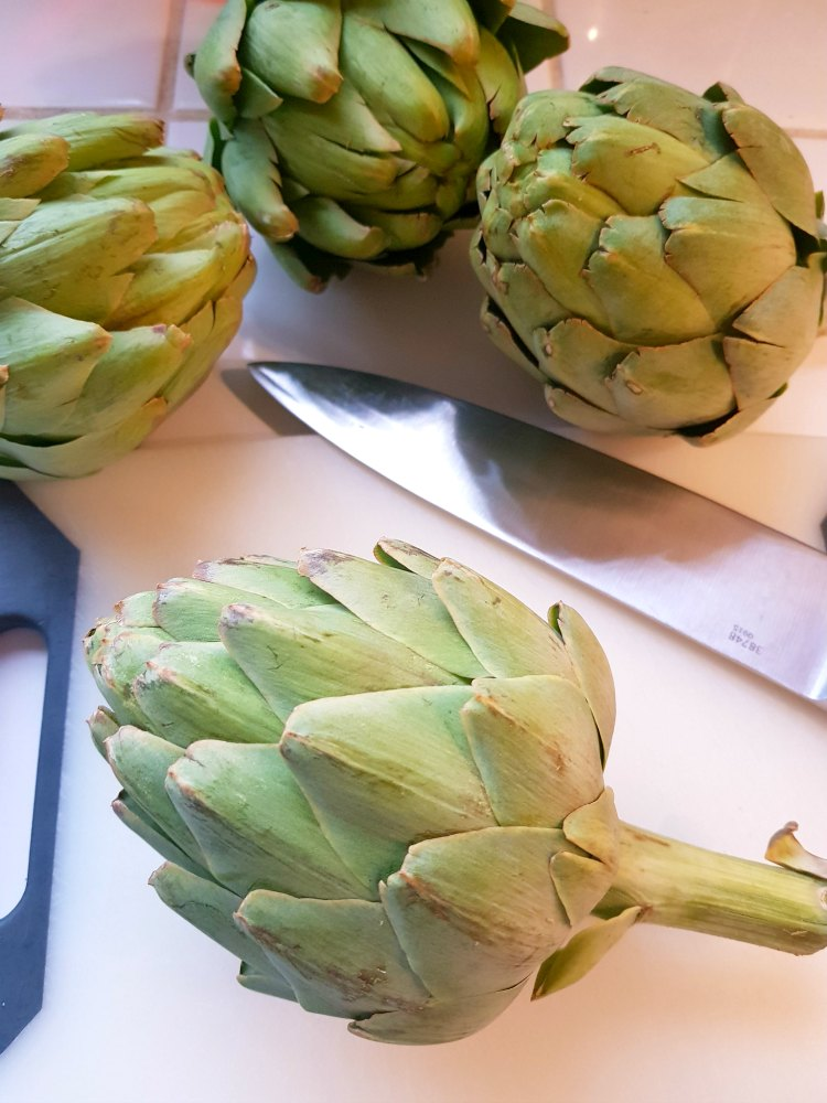cut your artichokes across the top for steaming