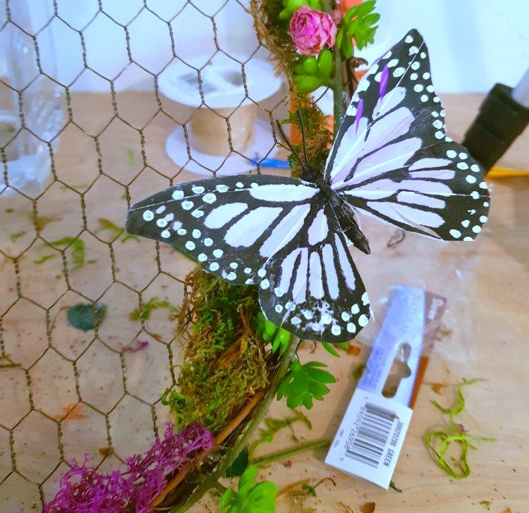 Adding butterflies to a succulent wreath. DearCreatives.com