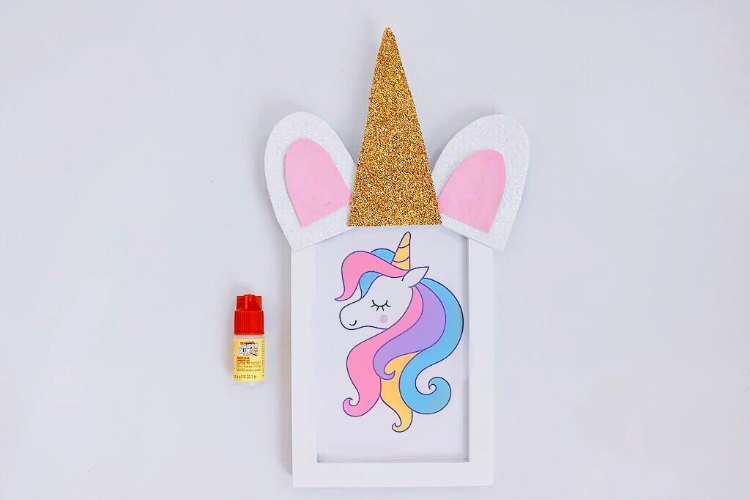 Glue on horn, and ears to your frame. Steps to decorating your unicorn frame. DearCreatives.com