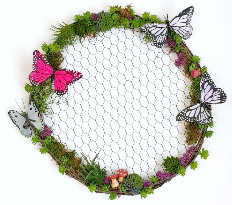 nature inspired wreath with succulents, and butterflies on a grapevine wreath with chicken wire. home decor ideas © 2018 Theresa Huse -DearCreatives.com