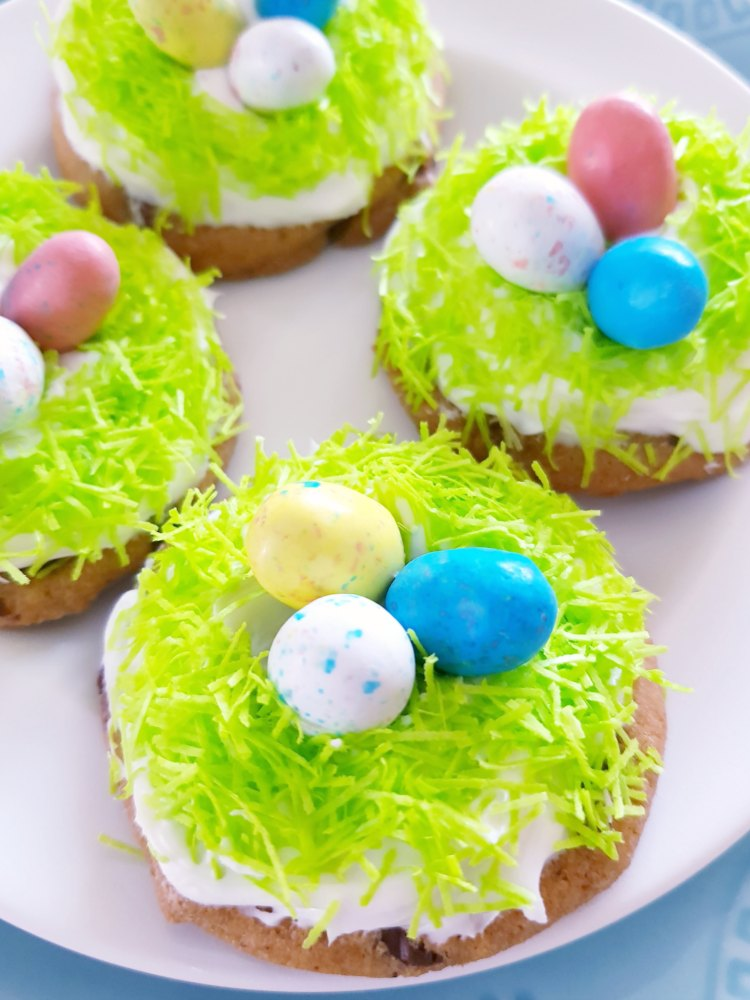 plate of decorated robins nest Easter cookies- Easter Cookies that are so easy to make. This will make you love decorating Easter cookies, it's a no fail easy recipe. Grab it at DearCreatives.com