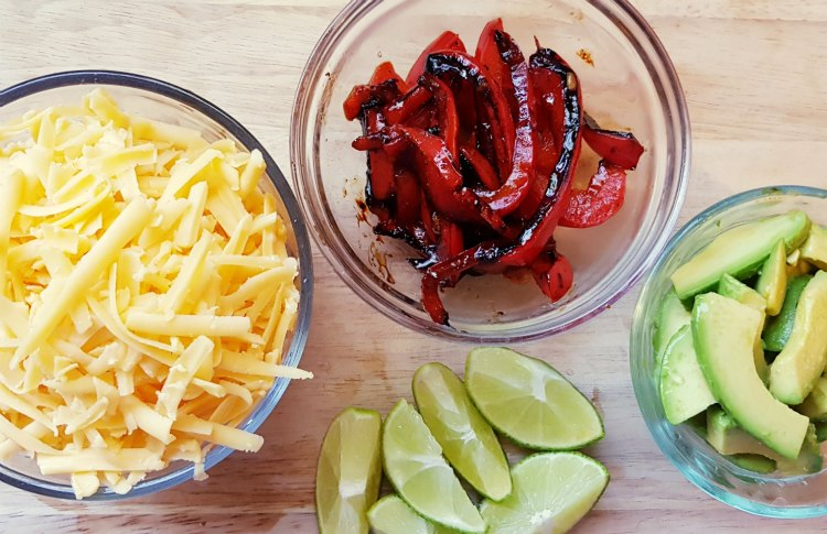 toppings for chicken fajitas tacos or burritos. shredded cheese, avocados, roasted red bell peppers, limes. DearCreatives.com