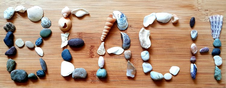 Beach spelled out with sea shells and rocks #WWF2 DearCreatives.com