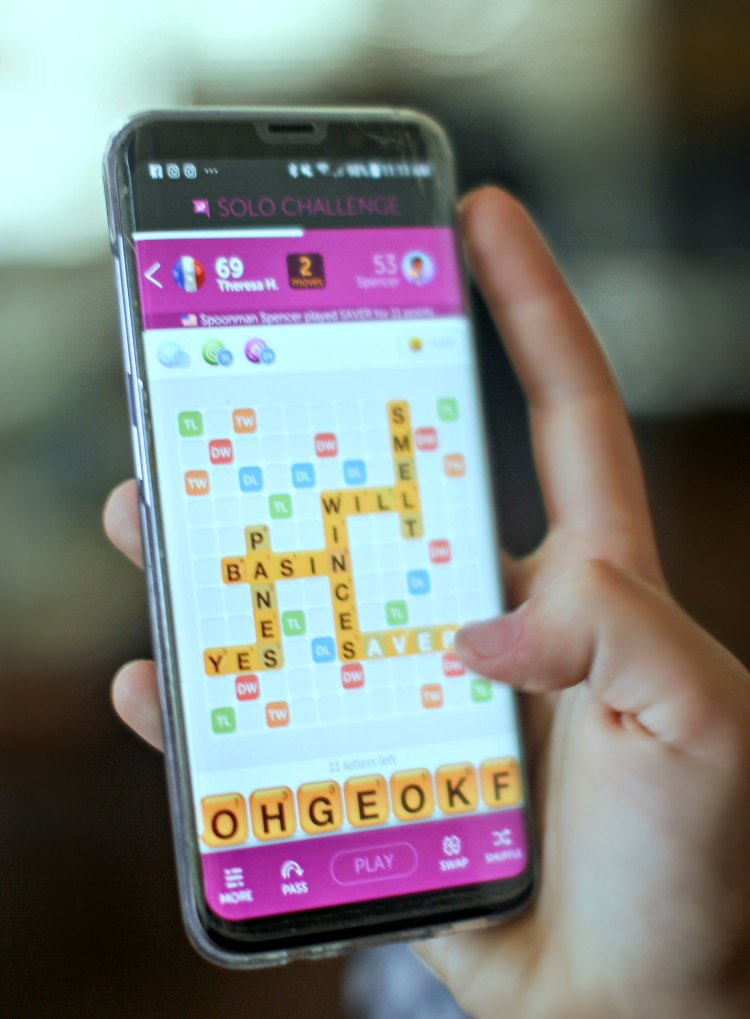 moving the letter tiles around the mobile game words with friends 2, brain teaser © 2018 DearCreatives.com