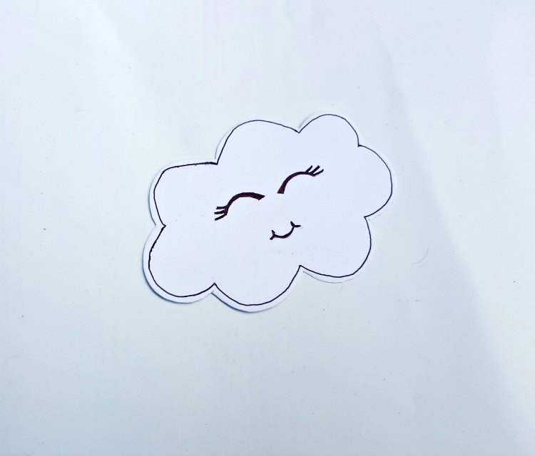 step (2) outlining the cloud, add eye lashes, and smile for kids paper craft DearCreatives.com