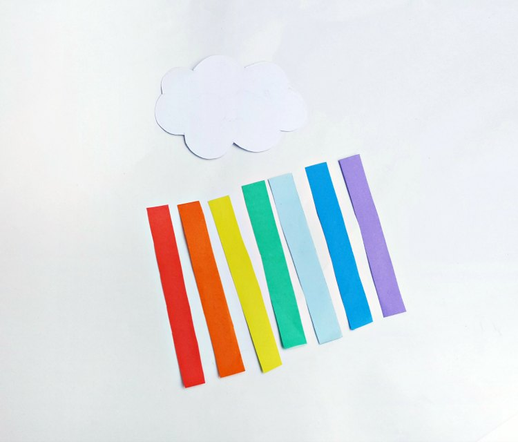 step (4) cloud with strips of color paper cut for the rainbow DearCreatives.com