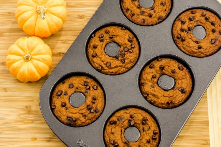 Paleo Pumpkin Chocolate Chip donuts in a pan. Recipe at DearCreatives.com