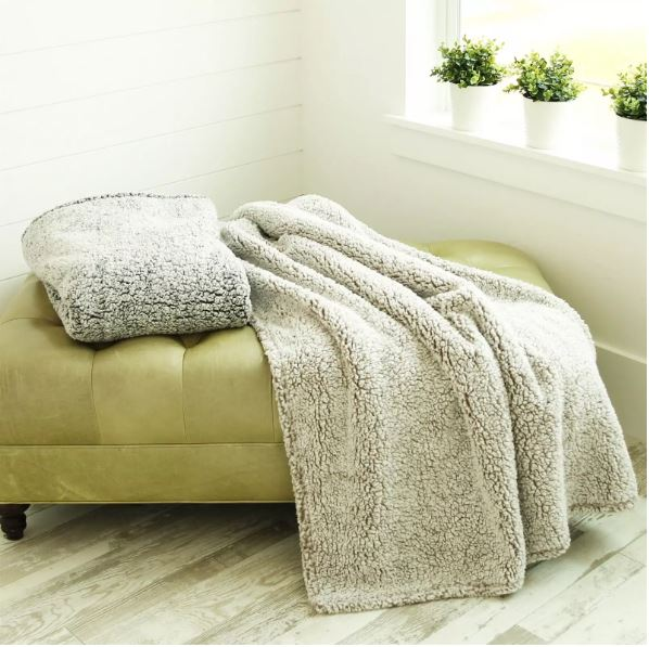 soft cozy sherpa blanket for fall or winter. this is a great blanket to toss over a chair or wrap in. Add this to your home decor's accent must haves.