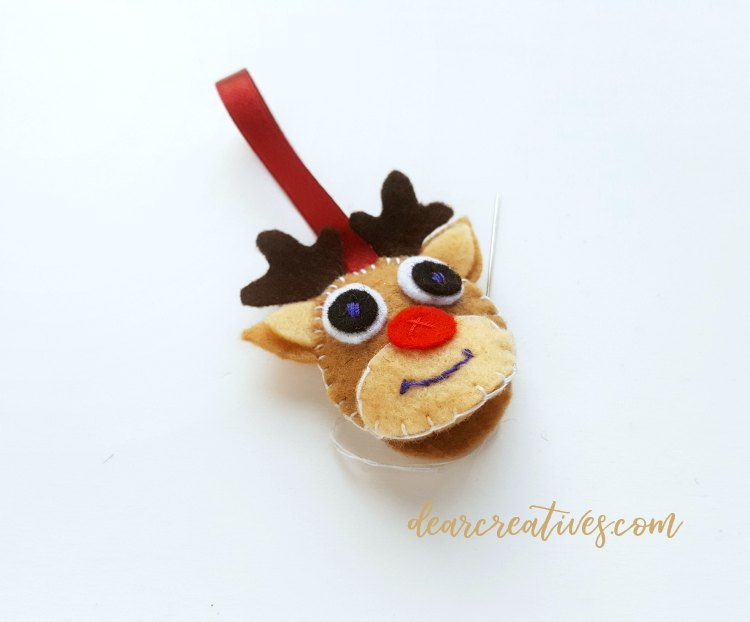 step (11) leave an opening at the bottom of the reindeer's head. follow diy at DearCreatives.com for this holiday ornament.