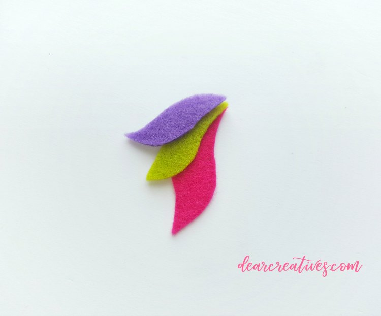 Over lapping colored felt pieces to create the unicorn tail step (16) DIY at DearCreatives.com