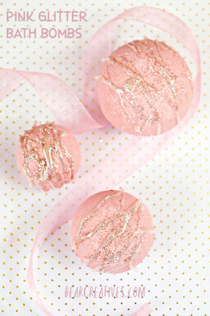 Pink Glitter Bath Bombs made with a pink champagne scent but, you can add your favorite scent to these and use the bath bomb tutorial at DearCreatives.com #bathbombs #bathbombsrecipe #pink #champagne #bathbombrecipelush