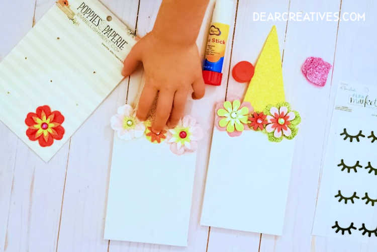 unicorn craft for a kids party Step 3. Now take your flowers and glue_stick them onto your canvas. See this easy kids craft at DearCreatives.com