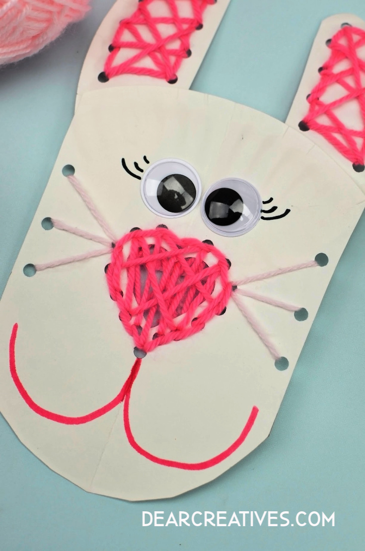 Add googly eyes by gluing on to paper plate and draw bunny mouth with a marker. Directions for this paper plate craft at DearCreatives.com