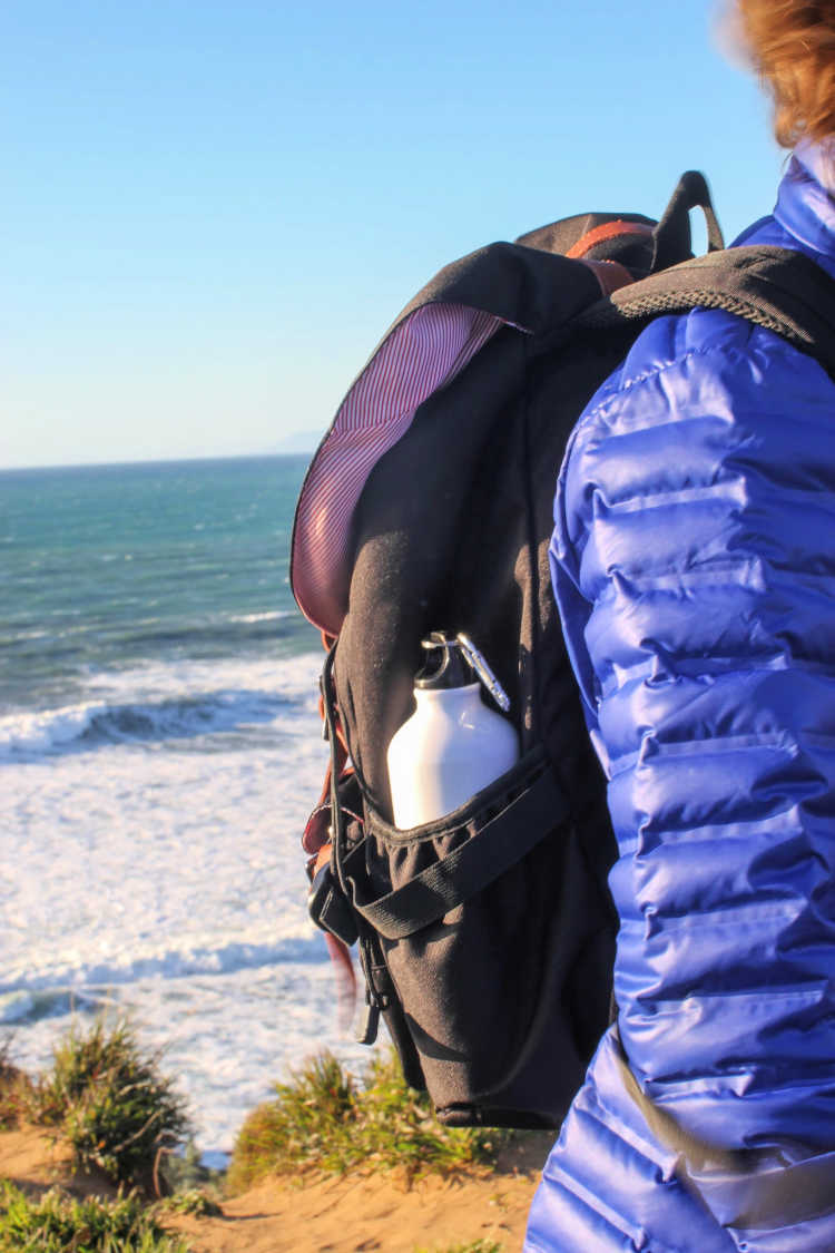 Hiking on the Central Coast, California - Carrying an american shield backpack with ocean in the background. © 2019 Theresa Huse DearCreatives.com
