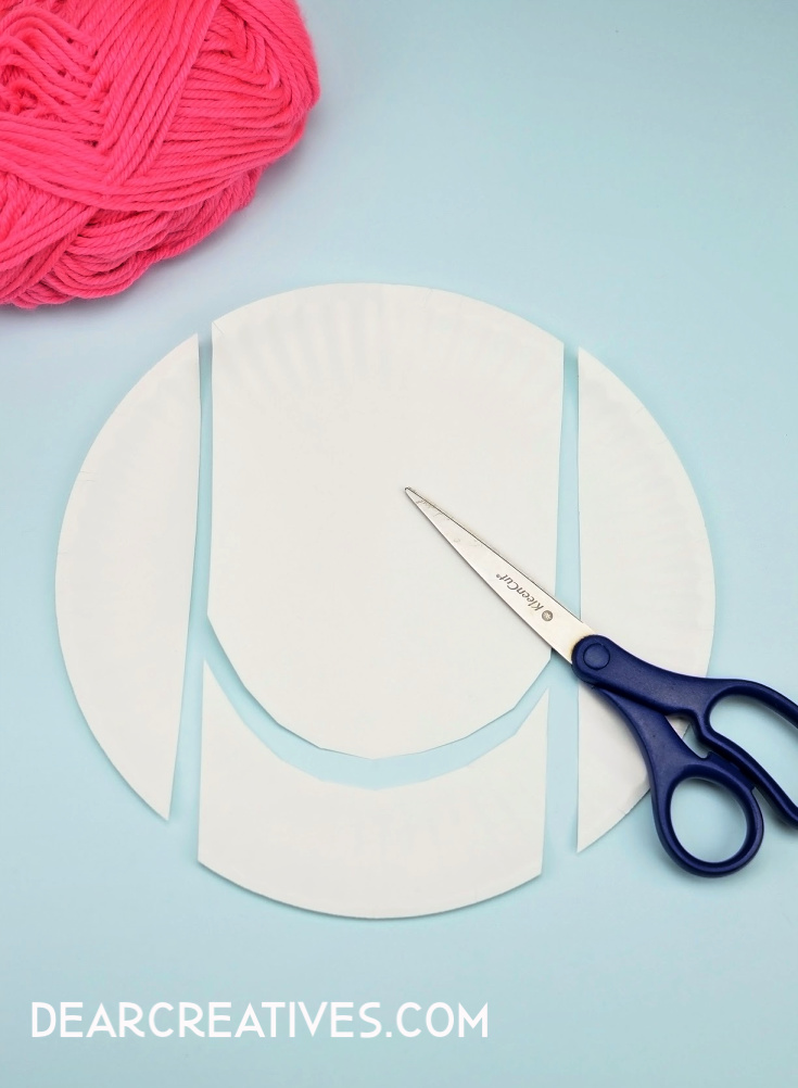 Step 1. Cut the paper plate as shown - See full directions for paper plate craft animals at DearCreatives.com