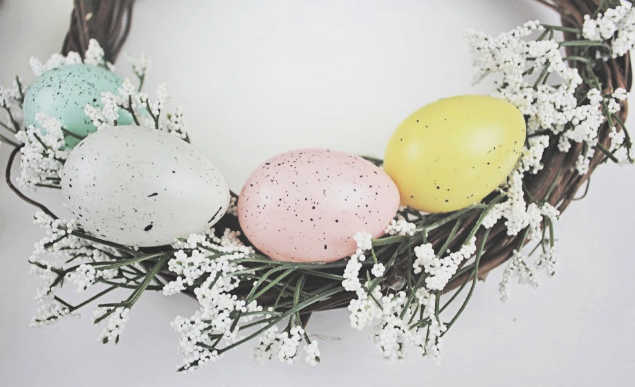 Repeat the process of adding eggs to the wreath- See full instructions and how to make an Easter egg wreath at DearCreatives.com