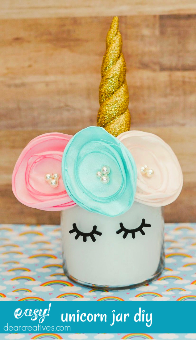 Unicorn Jar Topper - This unicorn jar diy is easy to make for your parties or for unicorn centerpieces. Find this diy so many more unicorn diys at DearCreatives.com #unicornjardiy #unicornjartoppers #unicornjars #unicorndiycenterpieces #dearcreatives