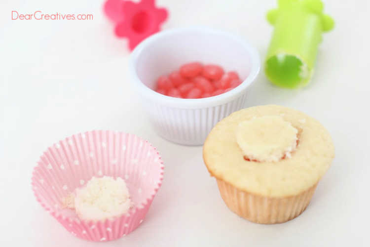 Add the tops back onto the cupcake covering up the jelly beans. Cupcake recipe and how to at DearCreatives.com