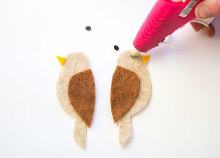 hot glue the eyes onto the felt bird. See how to make felt paperclip bookmarks at DearCreatives.com