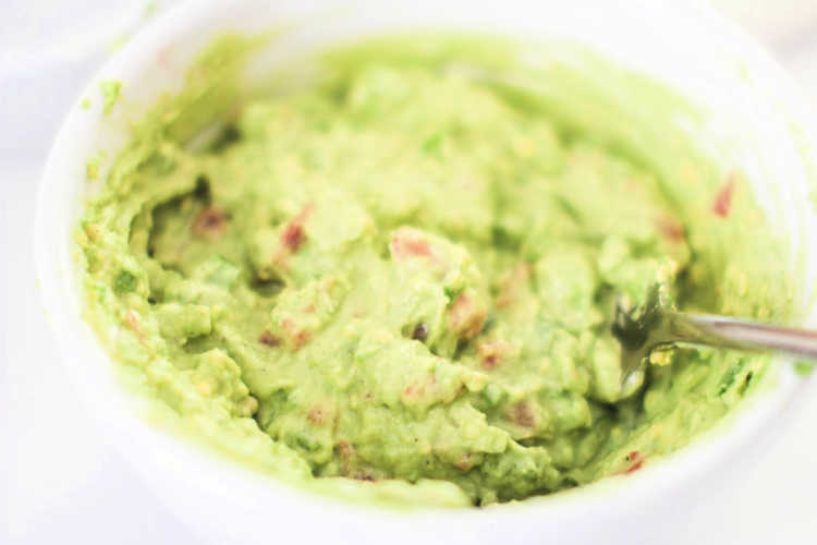 mix ingredients well until blended in a bowl to make your guacamole mixture © 2019 DearCreatives.com