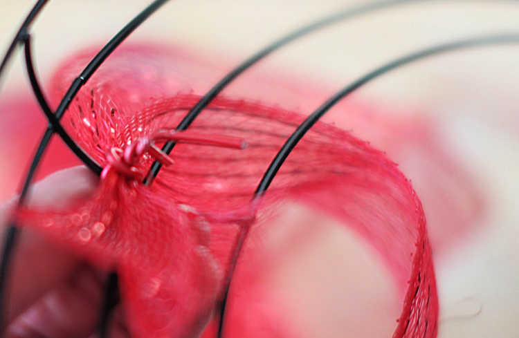 Begin making the wreath by wiring the mesh to the floral wire frame. DIY at DearCreatives.com