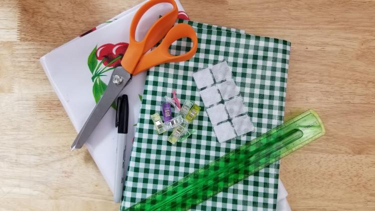 oilcloth fabric, sewing scissors, ruler, Velcro, thread...Supplies for making an oilcloth bag. DearCreatives.com