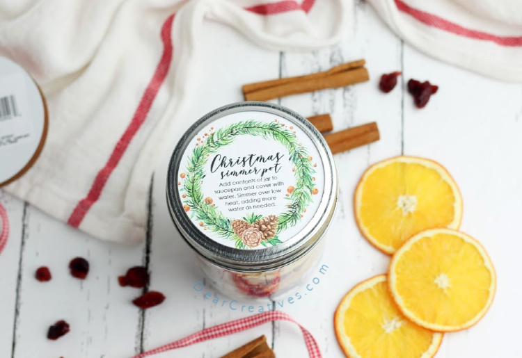 Adding the free printable label to the jar for a gift in a jar. DIY Potpourri recipe at DearCreatives.com