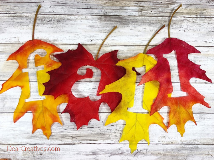Fall - Autumn craft leaves cut out, spelling the fall. Template and instructions for the DIY at DearCreatives.com