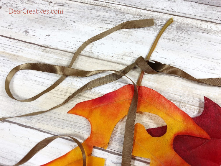 Getting ready to cut ribbon to make a fall banner. DearCreatives.com