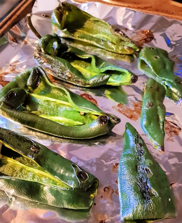 Poblano Peppers on a sheet pan - preparing for making stuffed peppers. DearCreatives.com