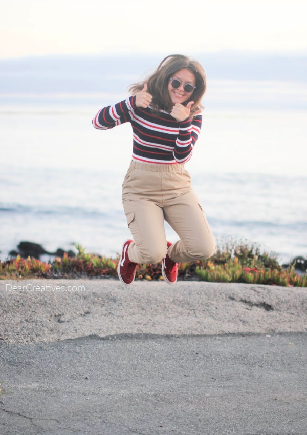 Young lady jumping for joy - wearing cute sunglasses... DearCreatives.com