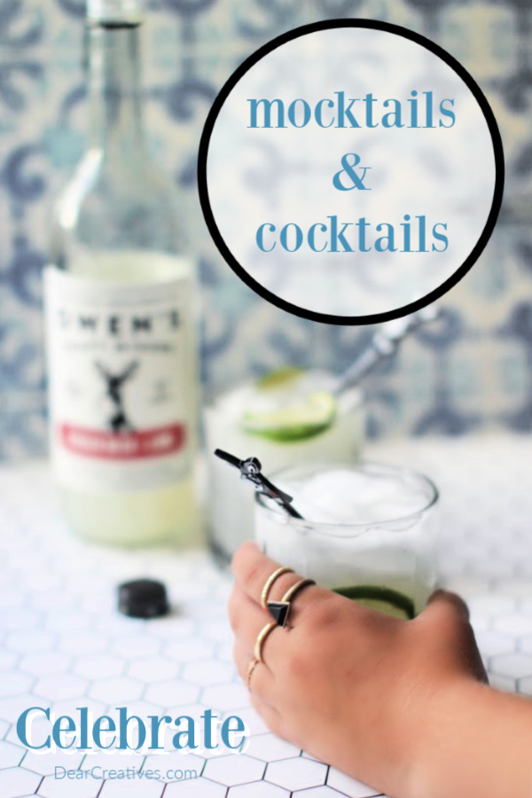 hand reaching for a drink in a glass garnished with lime - mixer for mocktails and cocktails - DearCreatives.com