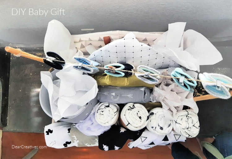 Looking down at all the gifts for the baby in a DIY baby shower gift. DearCreatives.com