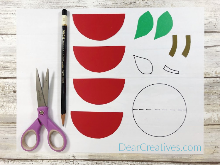 scissors, pencil and printable with cut outs for making a kids apple craft project - DearCreatives.com