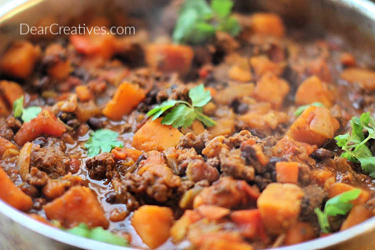 Chili With Squash - simmering on the stove. Grab this butternut squash chili recipe at DearCreatives.com
