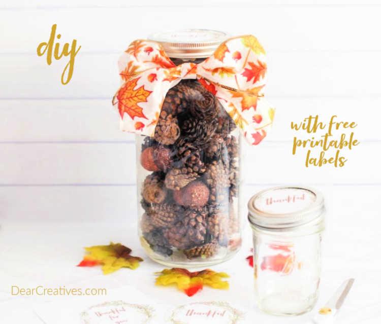 Mason Jar Crafts - Gift in a Mason Jar with Fall Printable Label -pinecones, mason jar, wired ribbon, easy fall craft ideas © DearCreatives.com