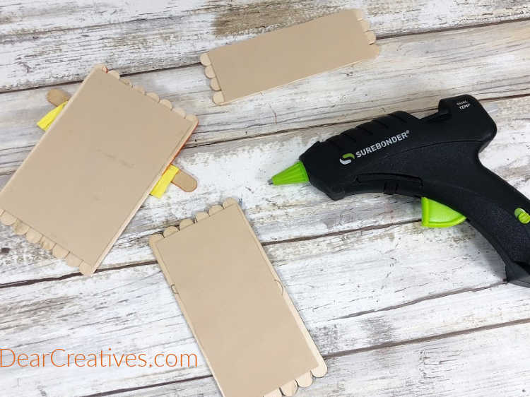 Attach each base group of wooden craft sticks to tan cardstock with a glue gun, trim excess cardstock with scissors... DearCreatives.com