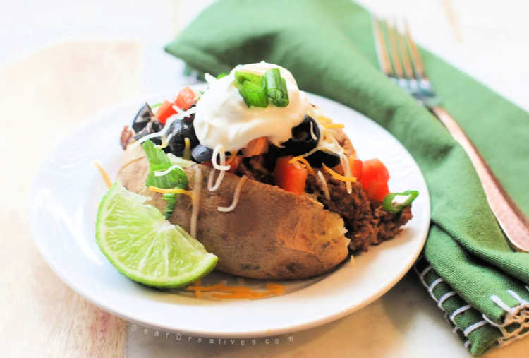 Taco Potato ready to be eaten. This is the best taco potatoes recipe, easy, tasty and tips for making it from scratch or quickly.© DearCreatives.com